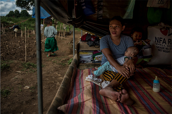 Arabian Denal, 28, with her 3-month-old son, Johore, inside a makeshift evacuation camp in Tagoloan, Lanao del Norte, last month. Credit Jes Aznar for The New York Times